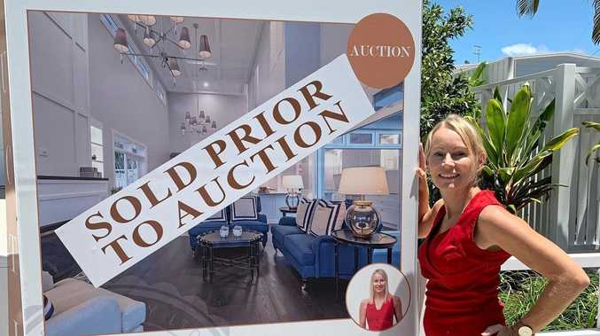 Joanne Marek of Marek Realty puts the SOLD sign up at 2/25 Edward St, Noosaville, ahead of Saturday's scheduled auction.