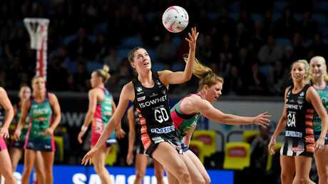 Matilda Garrett of the Magpies and Tegan Philip of the Vixens (right) contest the ball during a Super Netball match between the Magpies Netball and the Melbourne Vixens last year. (AAP Image/Tracey Nearmy)