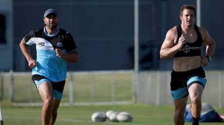 Shaun Johnson trains alongside fellow Sharks recruit Josh Morris. Picture by: Toby Zerna