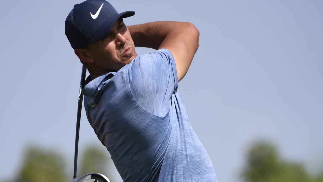 Brooks Koepka blasts an iron shot. AP/Martin Dokoupil