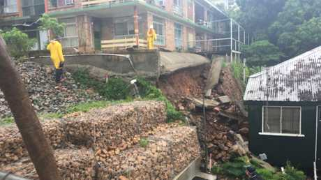 A Stanley Street unit complex is at risk of collapse as the wet weather floods the city. Photo: Tess Ikonomou