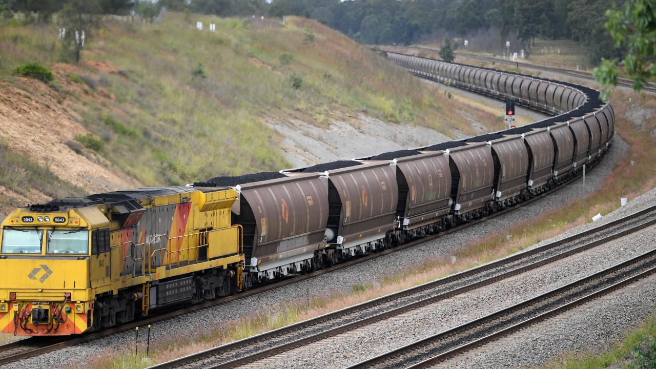 A loaded coal train passes through the outskirts of Singleton, in the NSW Hunter Valley.
