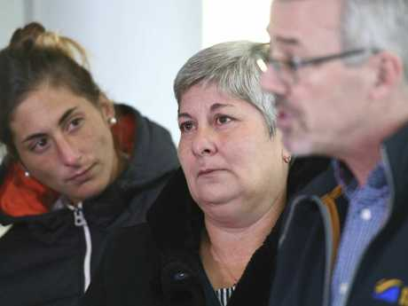 Emiliano Sala's sister Romina, left, and mother Mercedes, centre, listen to Blue Water Recoveries director David Mearns talk about plans to find and recover the plane. Picture: AP