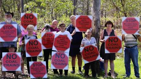 Members of the Inland Rail Action Group hold a protest about plans to introduce coal trains on the existing track.