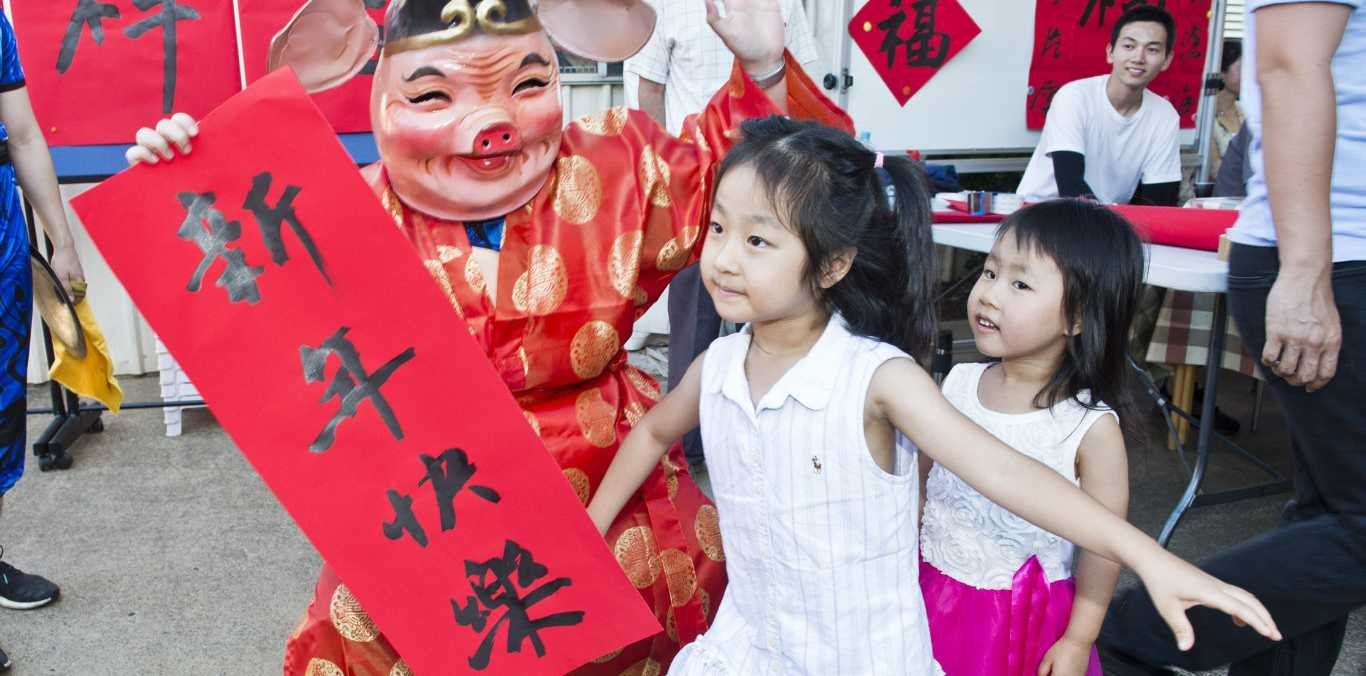 NEW YEAR CELEBRATION: Clair (left) and Tracey Qu celebrate the Year of the Pig at Pure Land Learning College.
