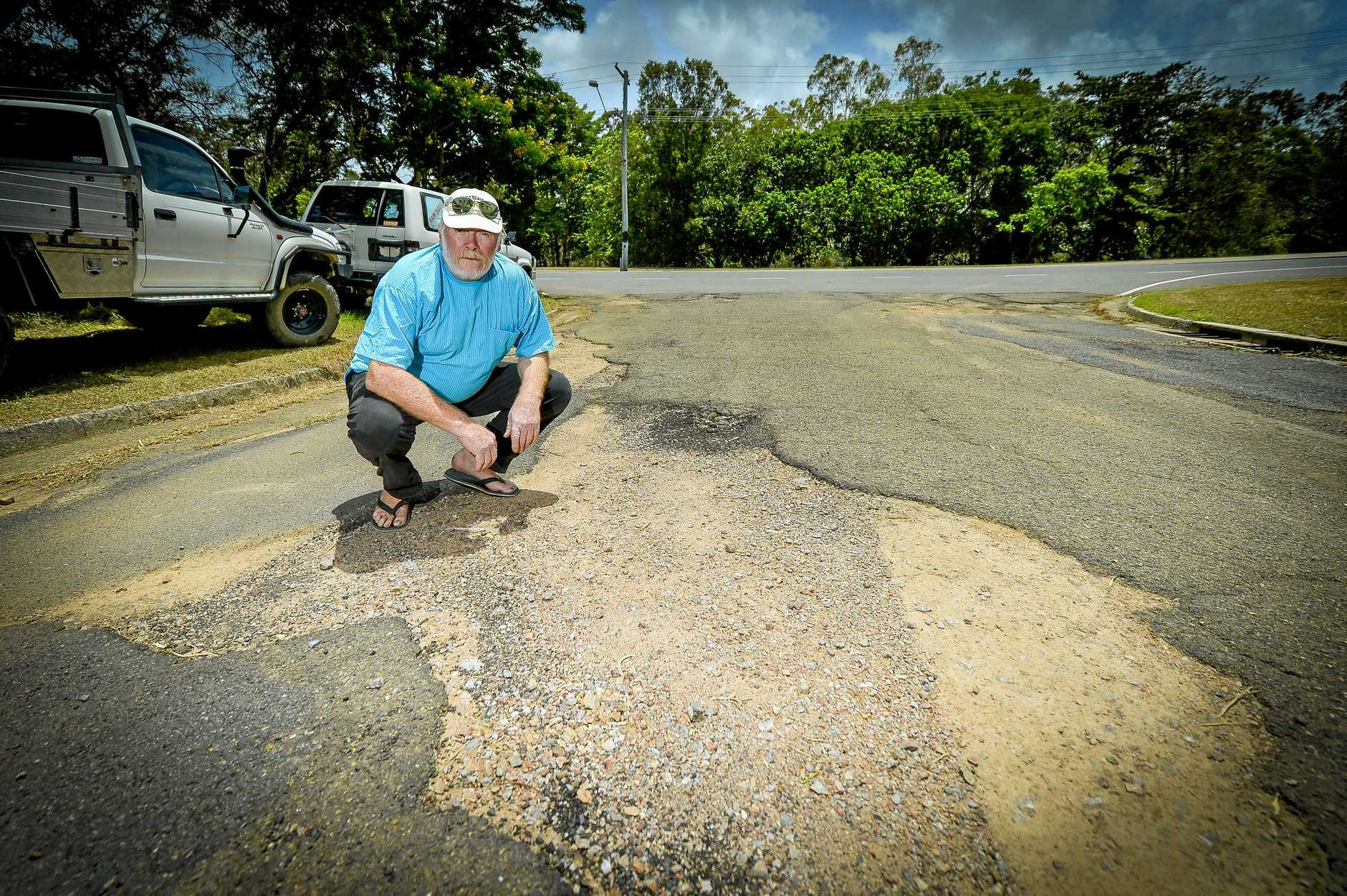 POTHOLES APLENTY: Gladstone resident Rob Melvin says he is struggling to get anybody to fix the access road beside his house .