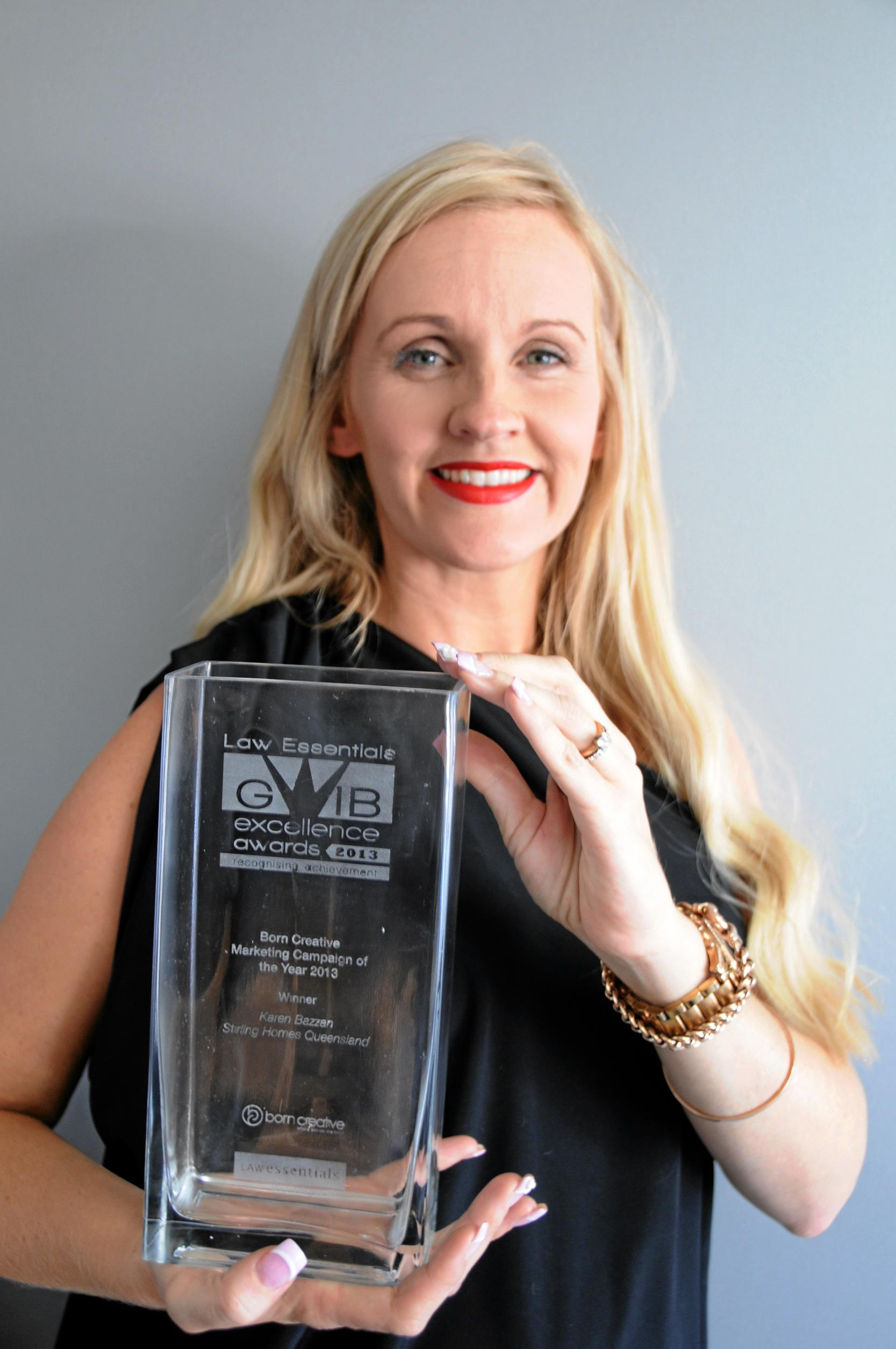 Karen Bazzan in 2013 with the Born Creative marketing Campaign of the Year award for Stirling Homes.