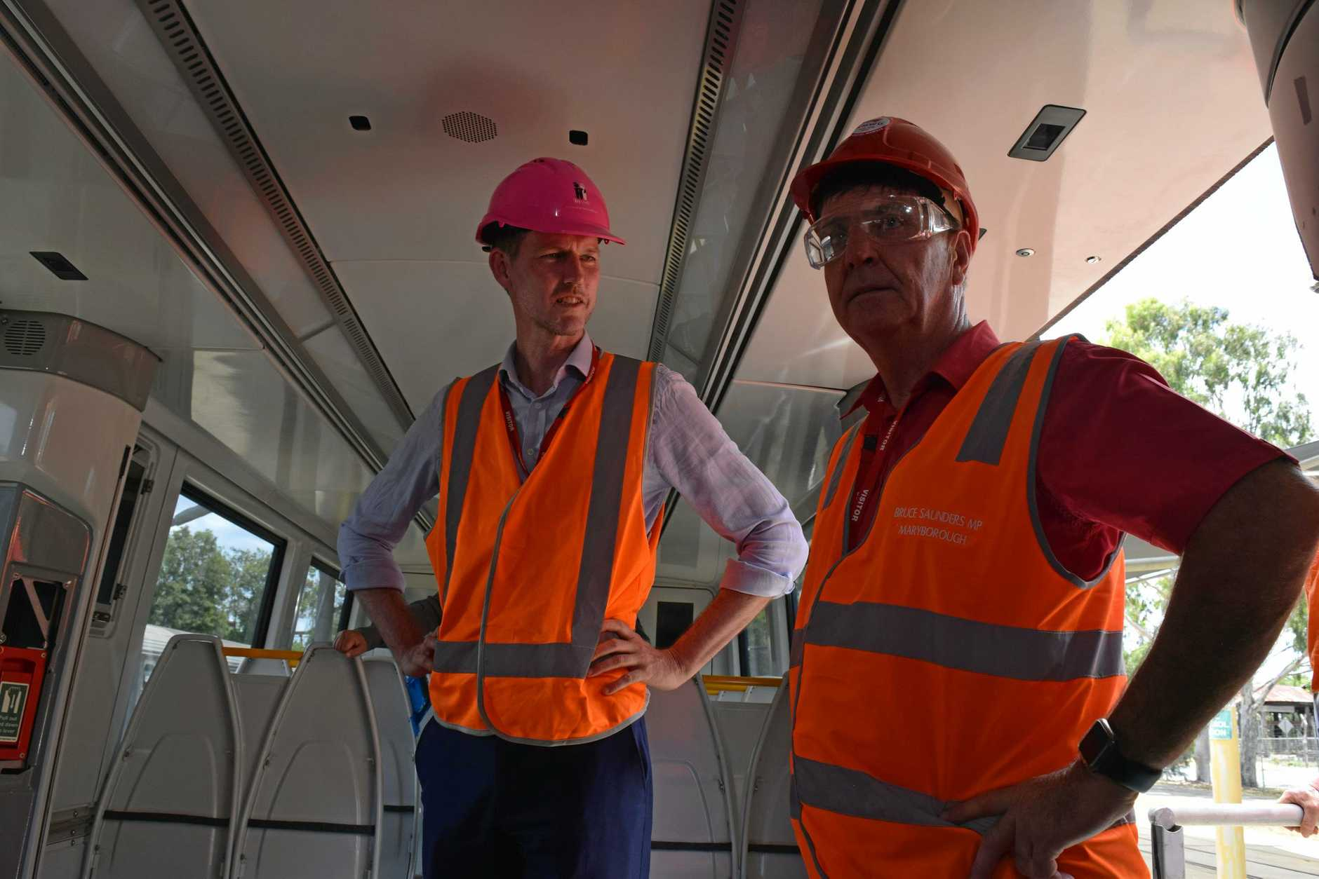 Transport Minster Mark Bailey with Maryborough member Bruce Saunders (right) in the first of 76 NGR trains to be repaied at Downer EDI.