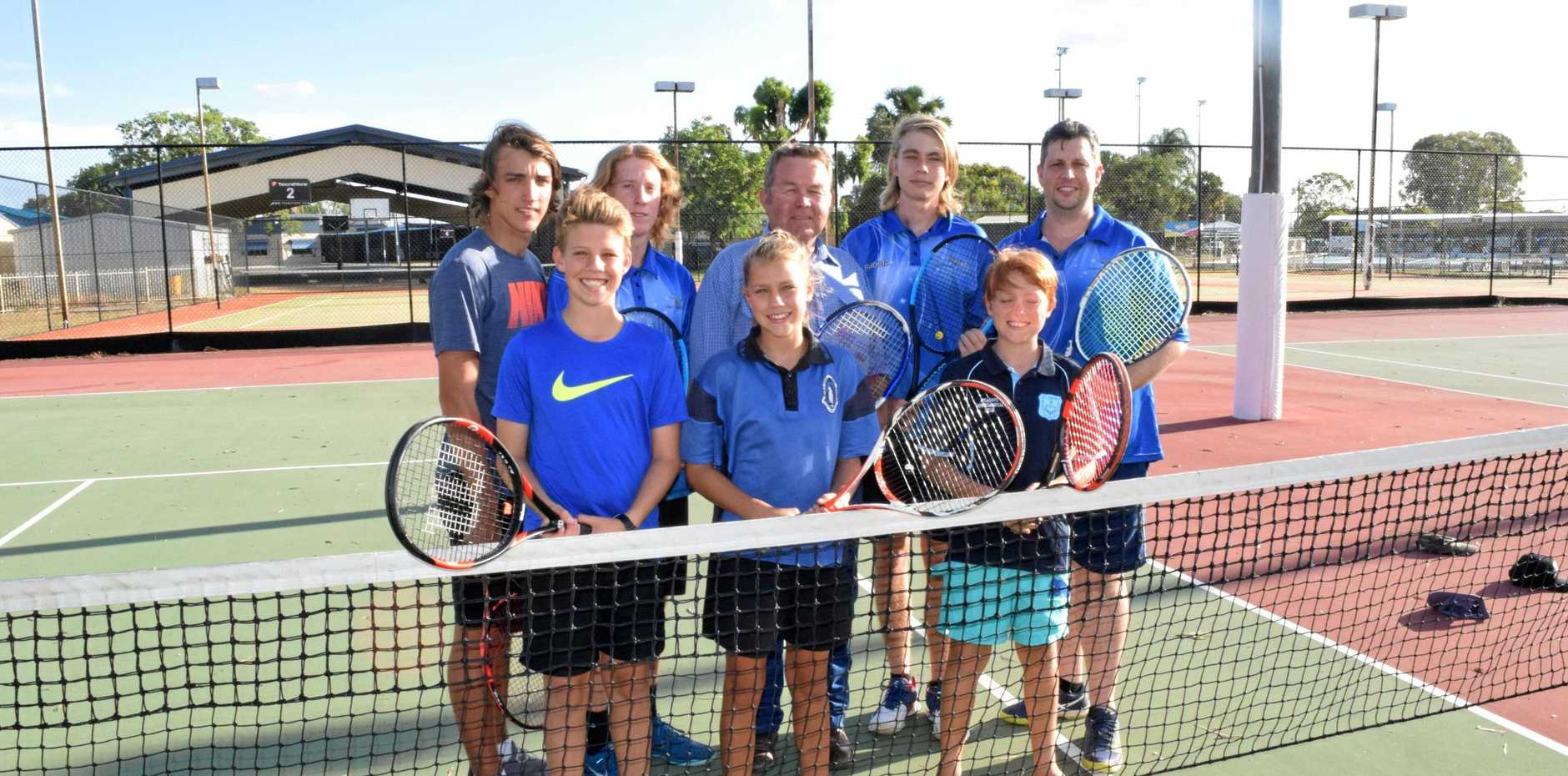 FUNDING ACE: Callide Valley Tennis players (back) Stuart Arnold, Owen Ambrey, with Colin Boyce MP, Noah Bongers and club president Tim Nelson. Front: Riley, Claire and Adam Arnold look forward to court upgrades.