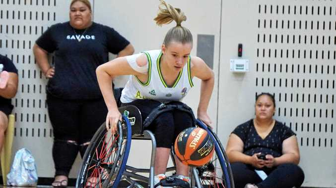 HUGE HONOUR: Sarah King playing for the Australian Under-25 Devils in an international series against Japan in Canberra. She also said she would love to take on her brothers Declan and Isaac in a wheelchair.