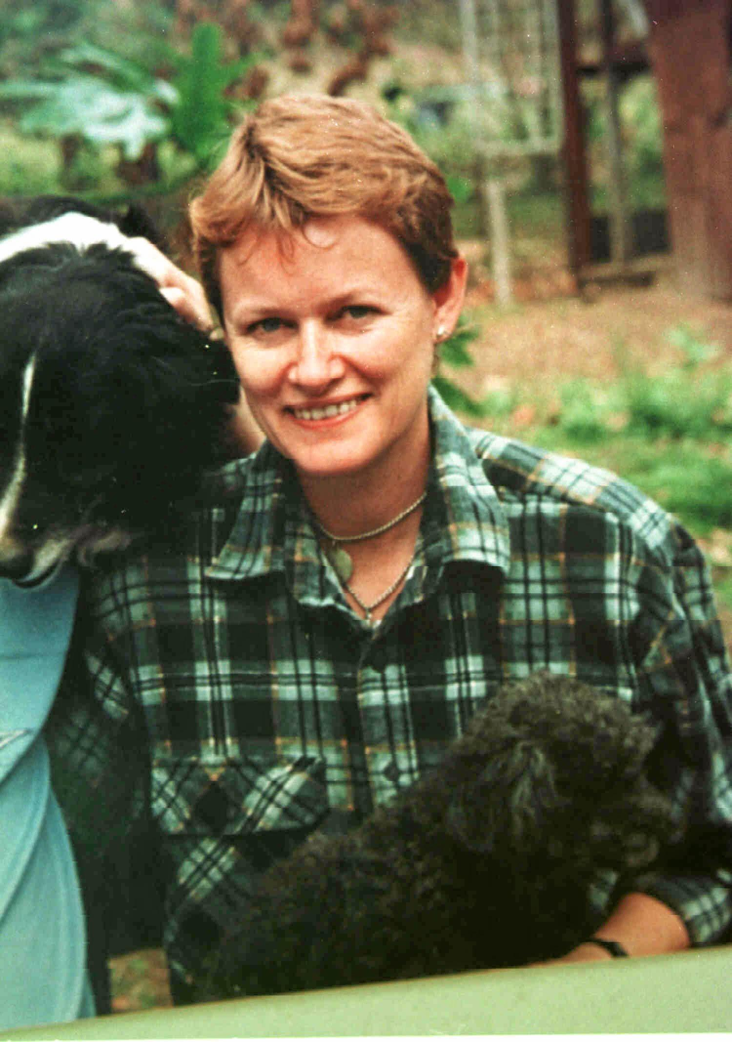 copypic/Parkes of Kenilworth woman Sabrina Ann Glassop holding her dogs - missing since late May 1999.  Headshot missing persons qld