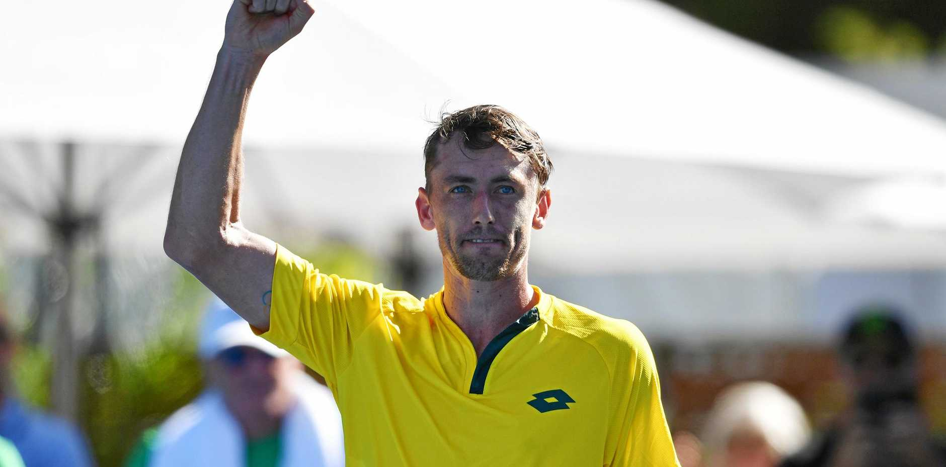 John Millman celebrates after winning first round match in the Davis Cup between Australia and Bosnia and Herzegovina at Memorial Drive in Adelaide. Picture: David Mariuz/AAP