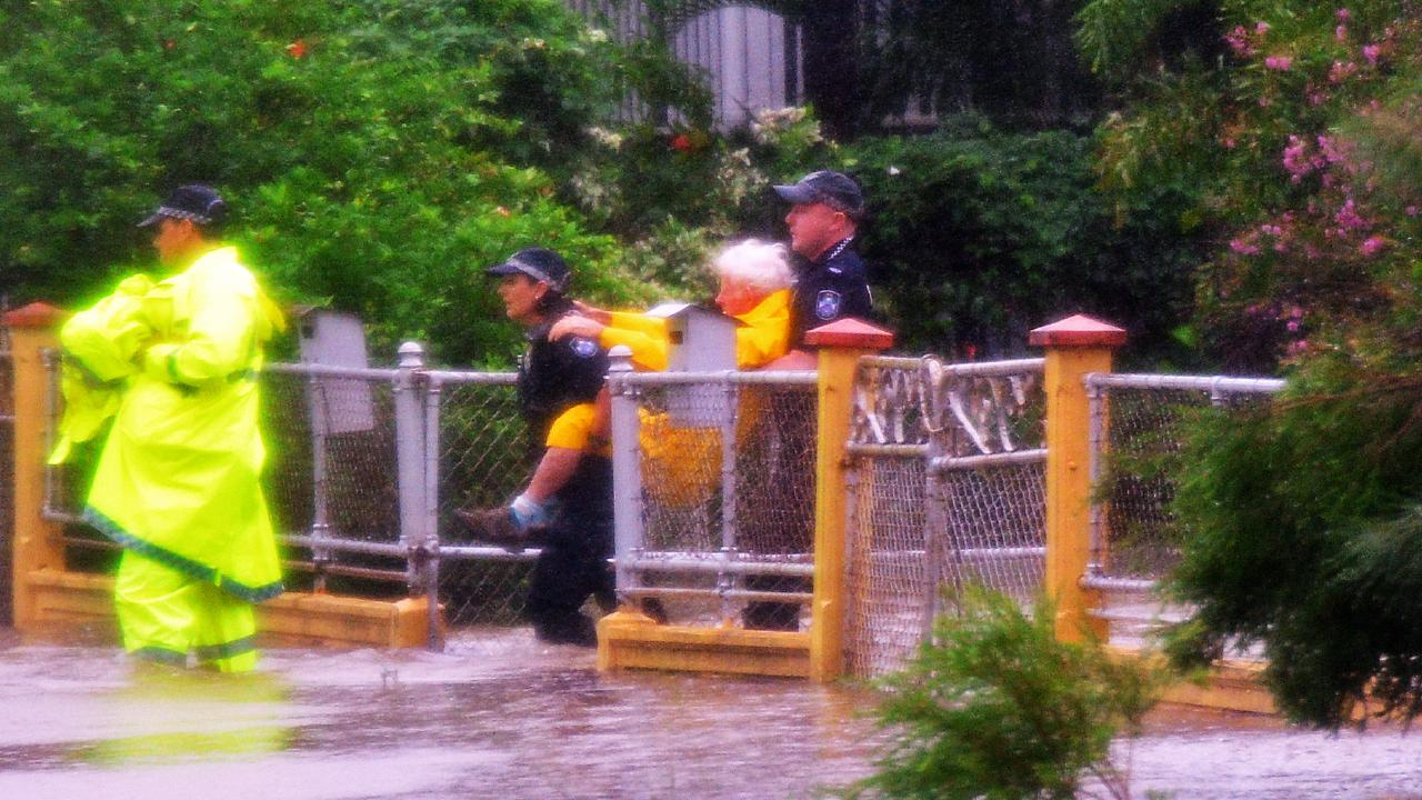 Police rescue an elderly from his Railway Ave home in Railway Estate. Picture: Zak Simmonds