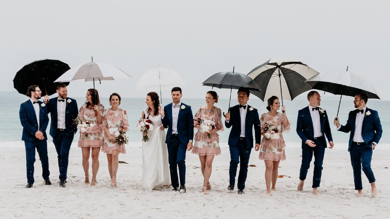 Hanna and Chris Brown with their bridal party at Jervis Bay. Picture: Alex Marks Photography