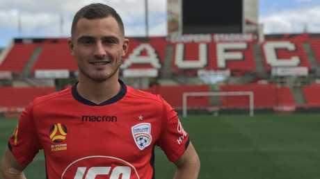 Adelaide United signing Jordy Thomassen at Hindmarsh.