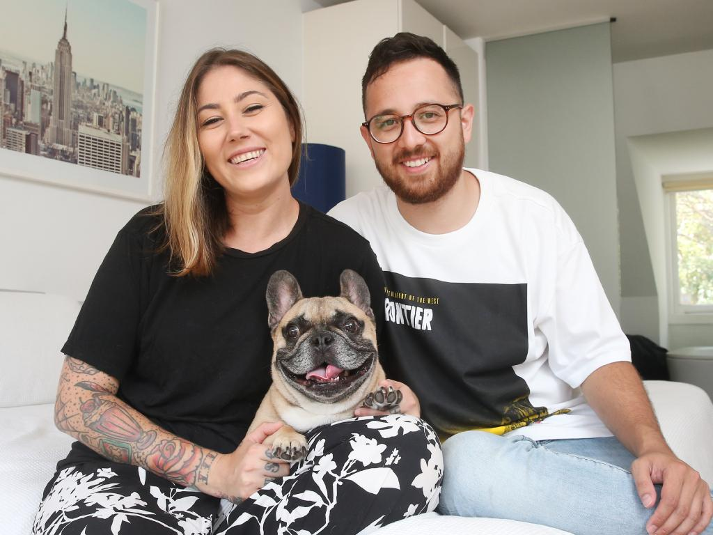 Sarah Prgomelja, 30, and fiance Jamie Hayman, 29. They leave the aircon on to keep their dog Edgar cool and sleep with it on when it's hot. Picture: Richard Dobson