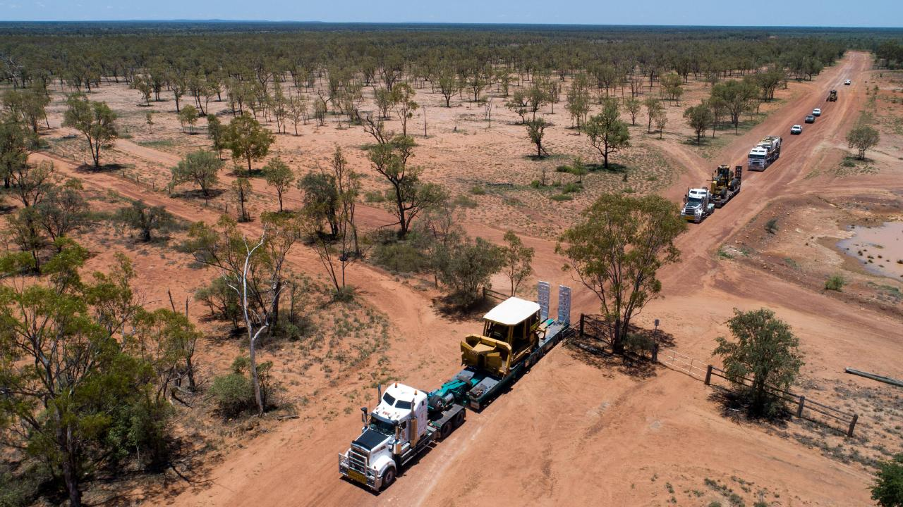 The first heavy equipment arrives at Adani's Labona Camp in central western Queensland to commence construction on Carmichael Mine last December. Photo: Cameron Laird