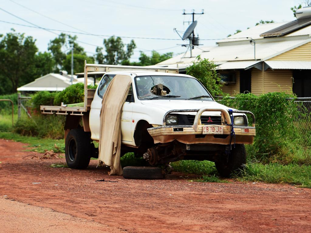 A ute collects dust outside of a local house in Beswick located 420kms from Darwin NT. Picture: Justin Kennedy