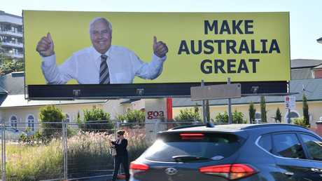A billboard featuring Australian businessman and former politician, Clive Palmer is seen on Vulture Street in the Brisbane suburb of Woolloongabba. Picture: AAP Image/Darren England