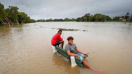 Moesha Graham and Azariah Spencer, both of Heatley, get ready for the start of the Barra season by fishing the swollen Ross River in Aitkenvale. Picture: Michael Chambers