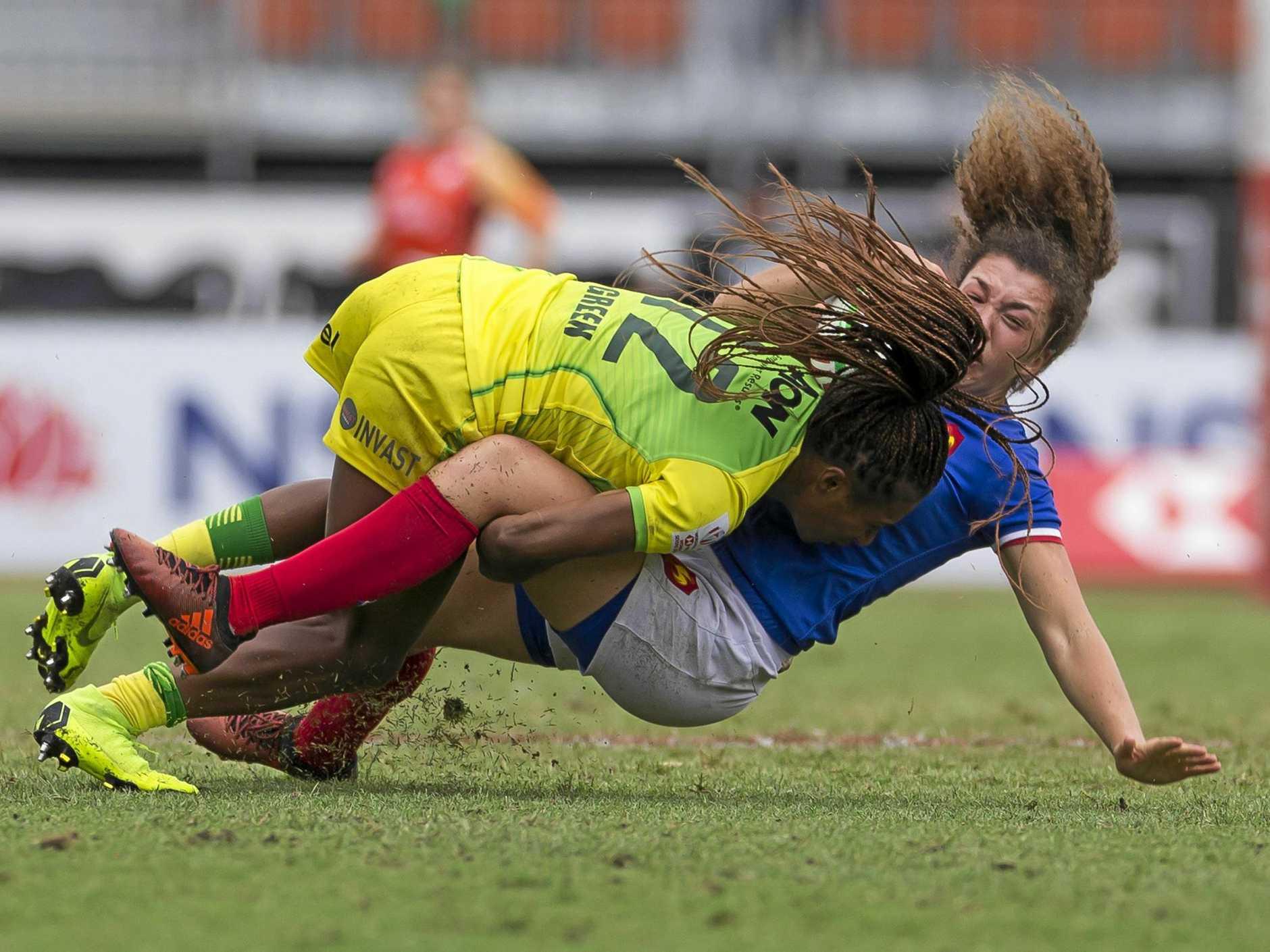 Australia's Ellia Green crunches France's Caroline Drouin at Sydney's Spotless Stadium on Saturday.