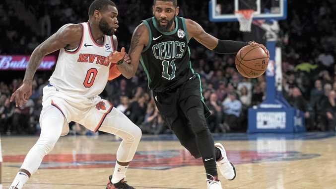 Boston Celtics guard Kyrie Irving drives to the basket past New York Knicks guard Kadeem Allen.