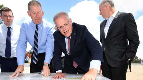 Australian Prime Minister Scott Morrison (centre) points at a map before making the funding announcement (AAP Image/Dan Peled)