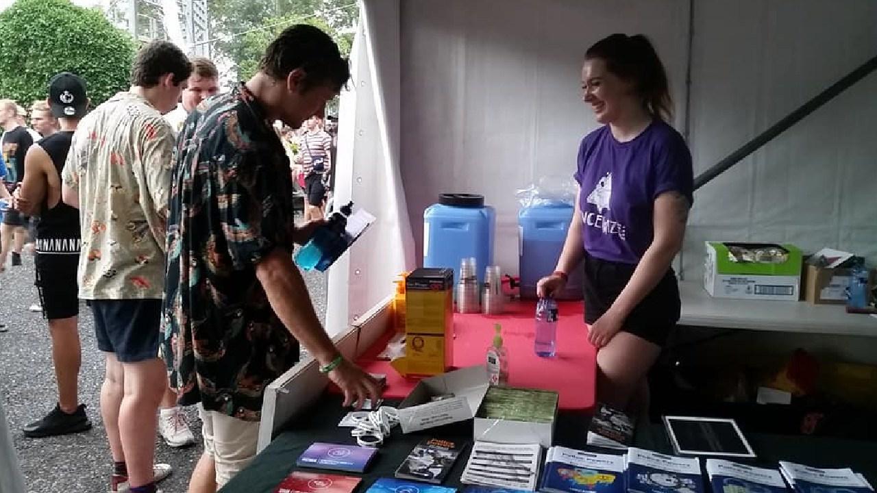 Key peer educator Caitlin Scally at a music festival.