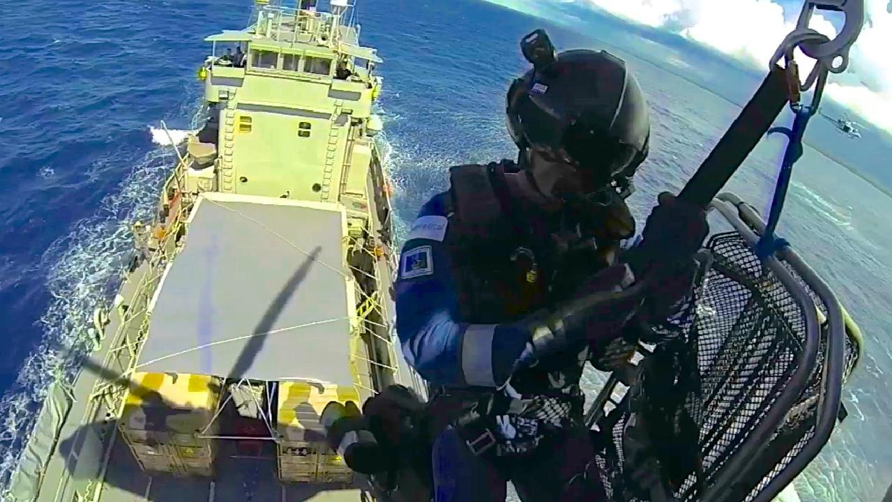 Paul Reeves on the end of a Navy winch in the South Pacific in 2013.