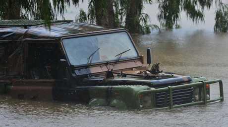 Sleepless night as deluge soaks 'disaster zone' Townsville, Queensland