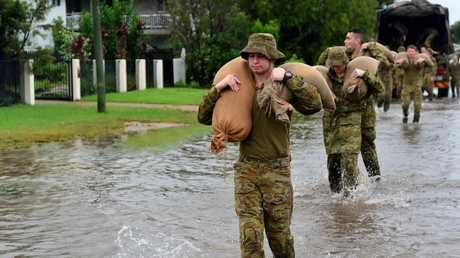 The army deploys to Railway Estate to sand bag properties. Picture: Evan Morgan