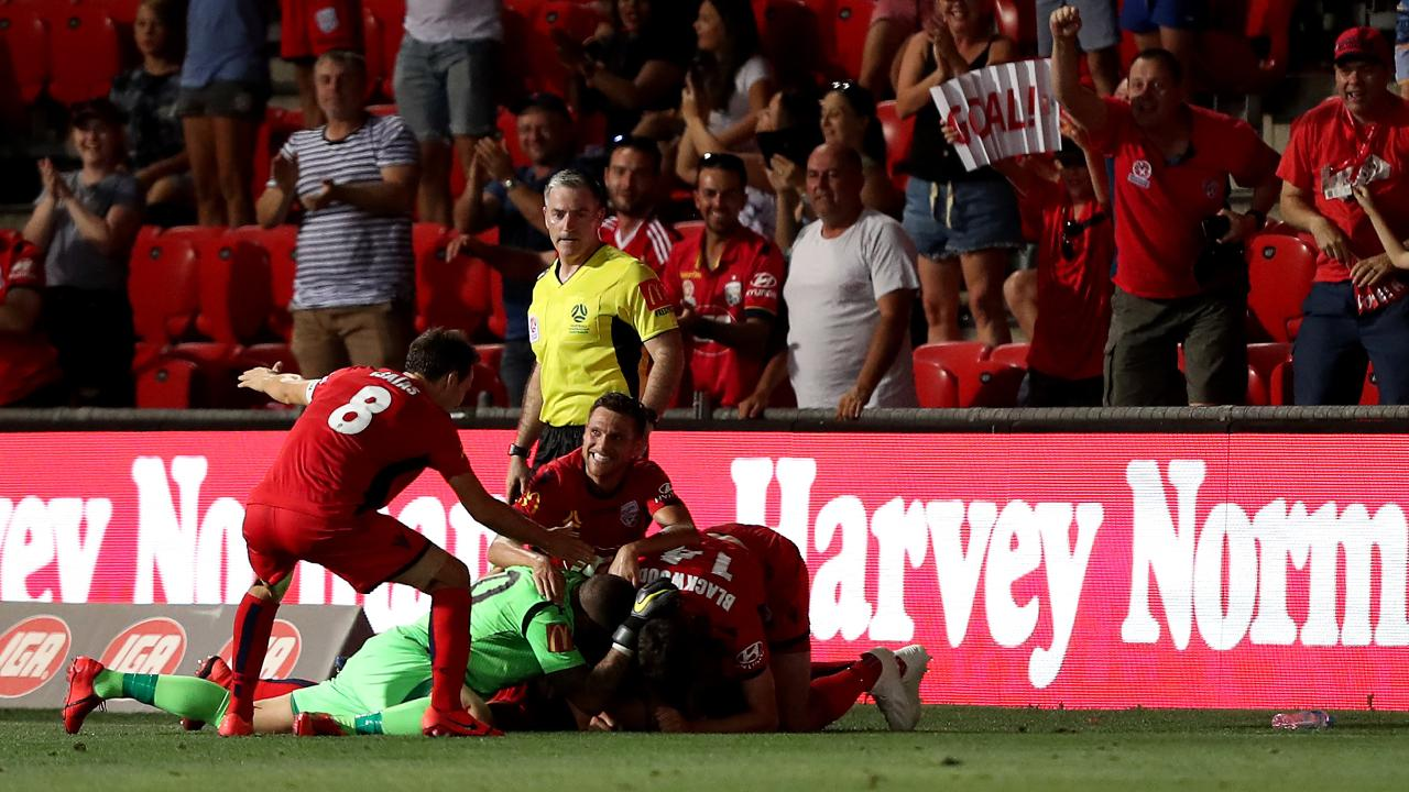Adelaide United celebrate their winning goal during the round 17 A-League match between Adelaide United and the Brisbane Roar at Coopers Stadium. Picture: James Elsby/Getty Images