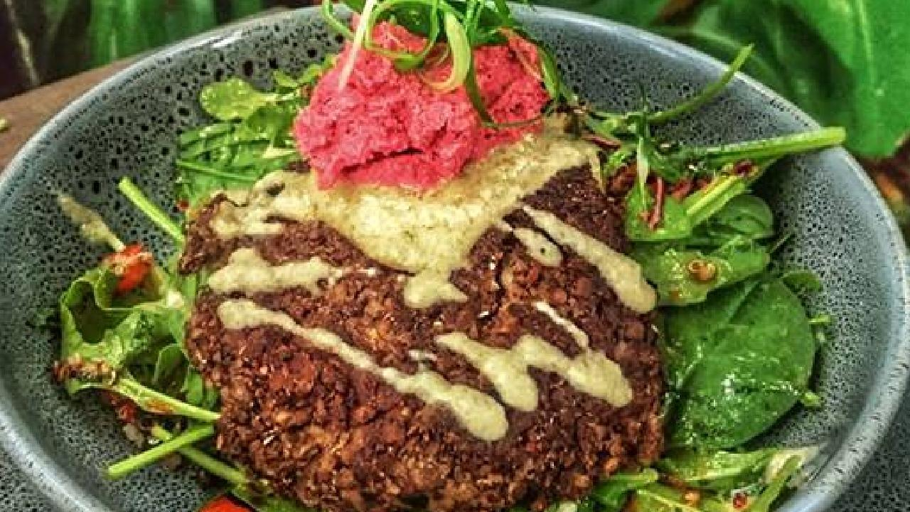 Cairns cafe Brother Jenkins has created a blackbean, mushroom and quinoa patty on a hearty salad served with beetroot hummus and tahini, walnut aoli.