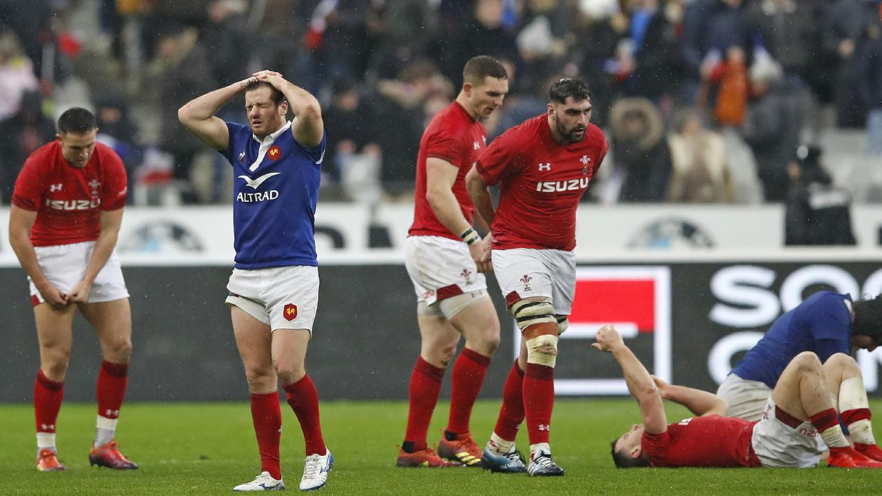 Wales and French players react after the Six Nations international at the Stade de France. Picture: AP