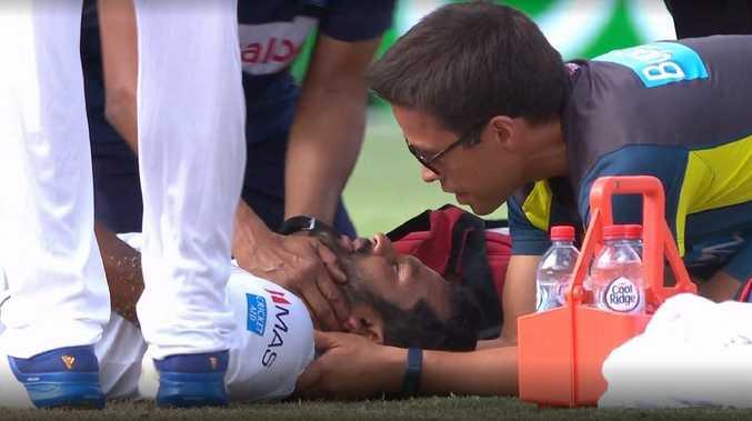 Dimuth Karunaratne gets medical attention.