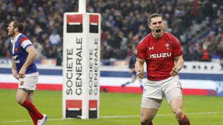 Wales' George North celebrates after scoring his side's third try at the Stade de France. Picture: AP