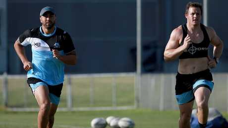 Shaun Johnson with fellow new Sharks signing Josh Morris.  Picture: Toby Zerna