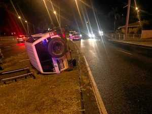 Car rolls over in wet weather late at night
