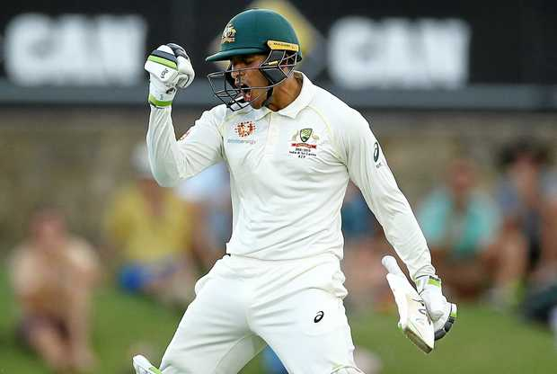 Usman Khawaja celebrates after reaching his century.