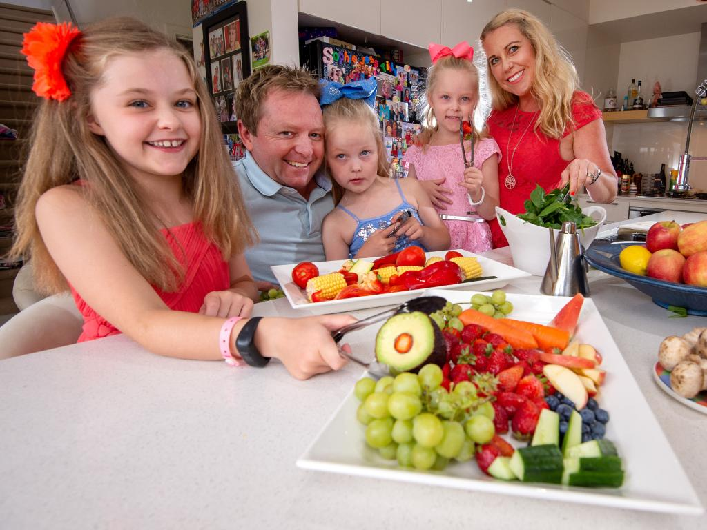 Scott and Fiona Annett with their kids, Sophie, 8, and 6-year-old twins Tilly and Jessie with healthy produce. Picture: Jay Town