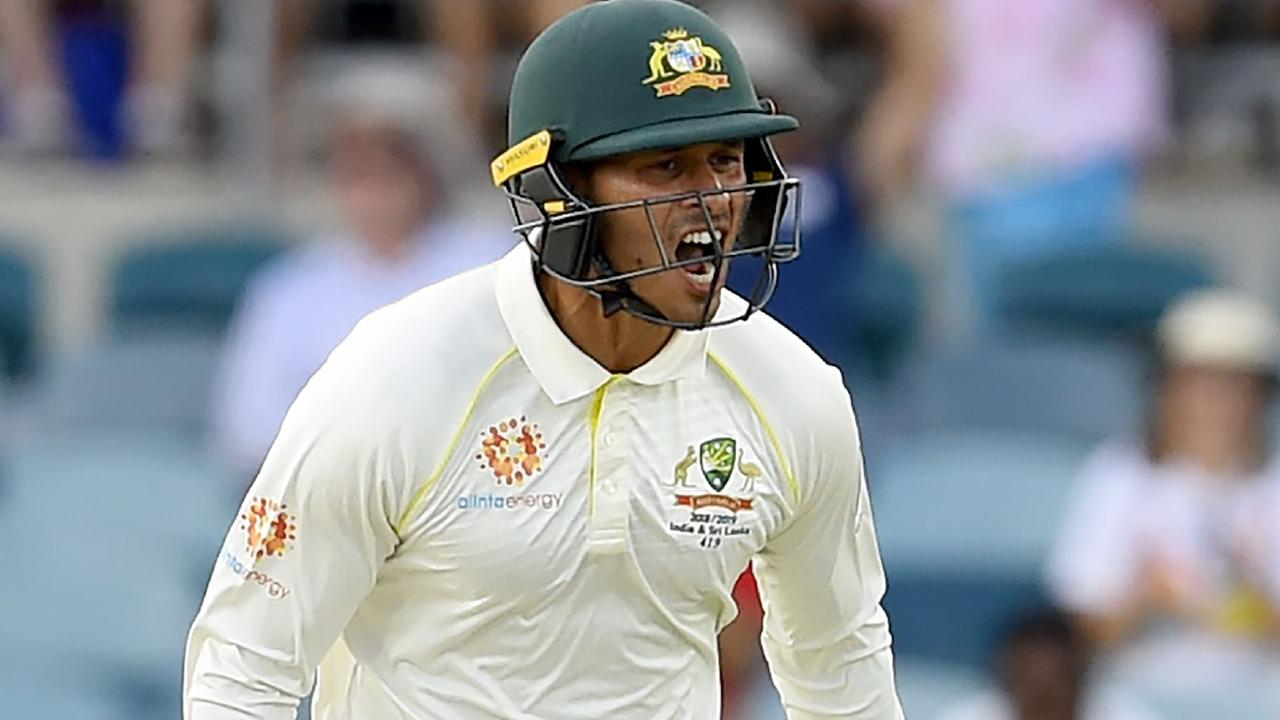 Usman Khawaja celebrates reaching his century. (Photo by ISHARA S. KODIKARA / AFP)