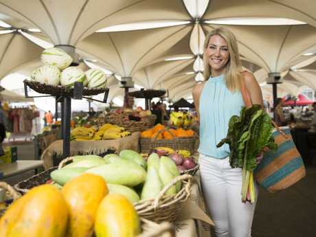 Eat Real campaign ambassador and TV presenter Jaynie Seal browsing for fresh produce at the growers markets in Fox Studios. Picture: Dylan Robinson