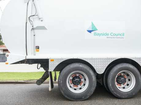 A Bayside Council garbage truck shows the rear wheels not lining up with the wheel arch and an iron bar attached to the back as a weight. Picture: Dylan Robinson