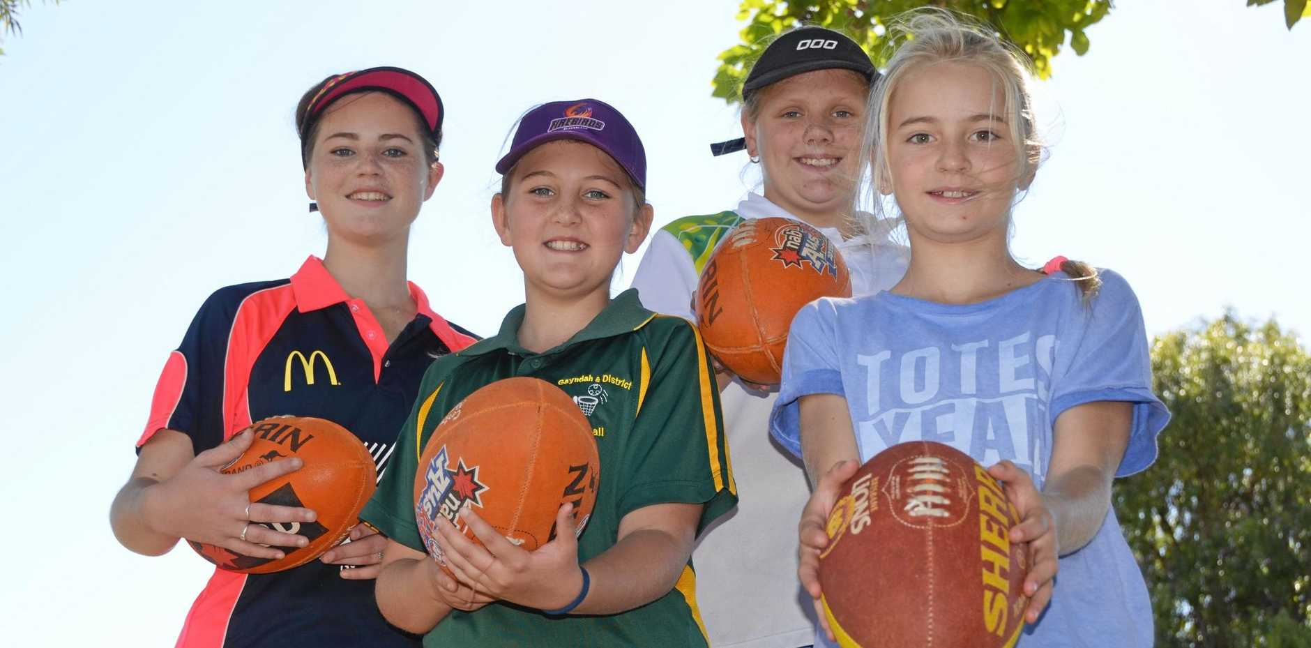 HAVING A BALL: Lauren Trott, Layla Roth, Sophie Doyle and Sian Bloor had a great time at the AFL holiday camp in Gayndah last year.
