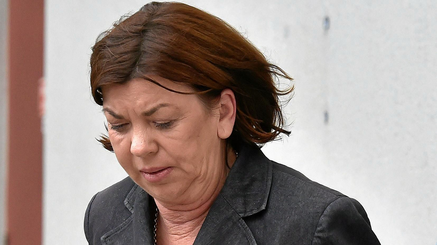 UNDER THE INFLUENCE: Principal of Chancellor State College Jacqueline Patricia King leaving the Maroochydore Magistrates Court. King was caught driving almost five-times the legal alcohol limit after she crashed into two cars while on her way to the college.