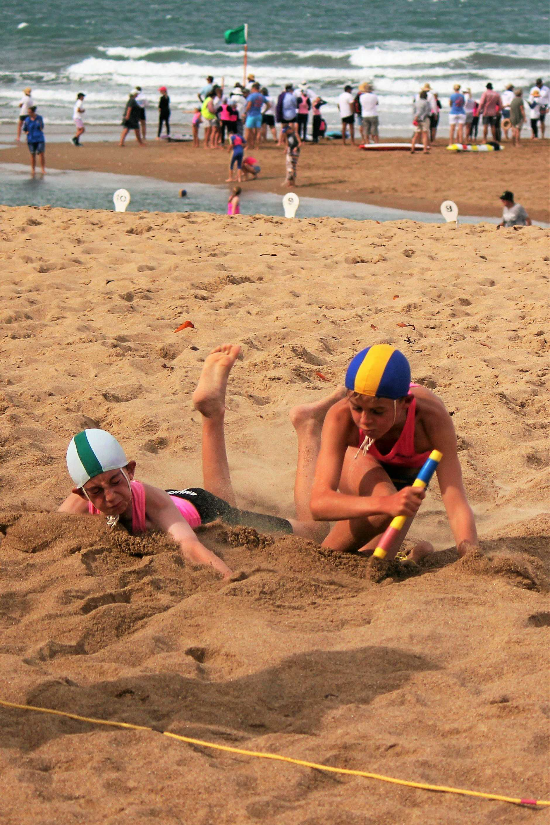 U12 Liam Morris (right) snatches himself another round in the Beach Flags.