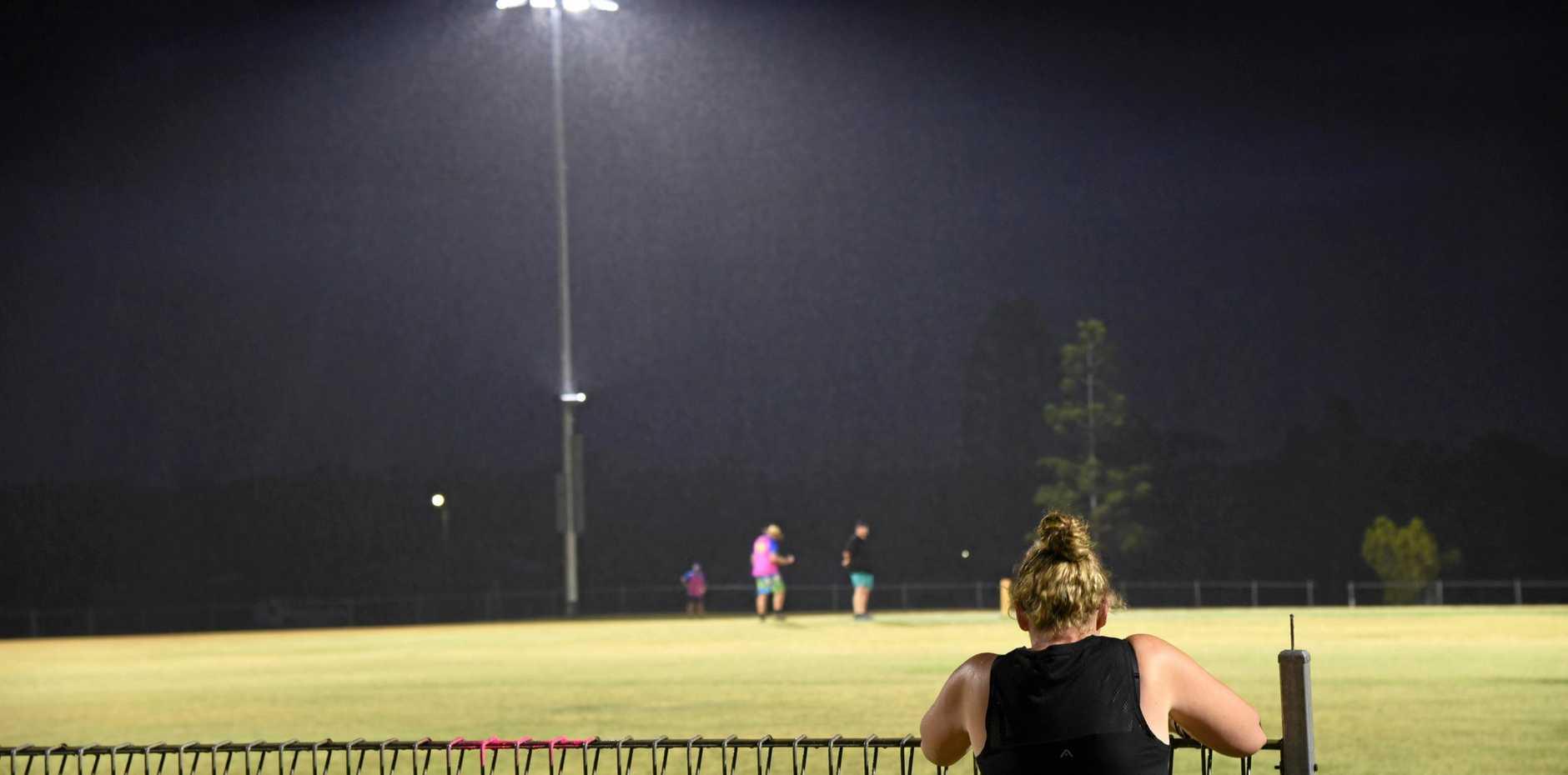 FAITHFUL: Shannon Eastcott braves the rain to support Royal Hotel Mundubbera's Bottom Pub over-40s team.