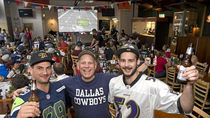Texan visitor John Hinton (centre) with Michael Laughren (left) and Scott Burgess at the Super Bowl party at the Spotted Cow with visiting business leaders from Texas, Monday, February 4, 2019.