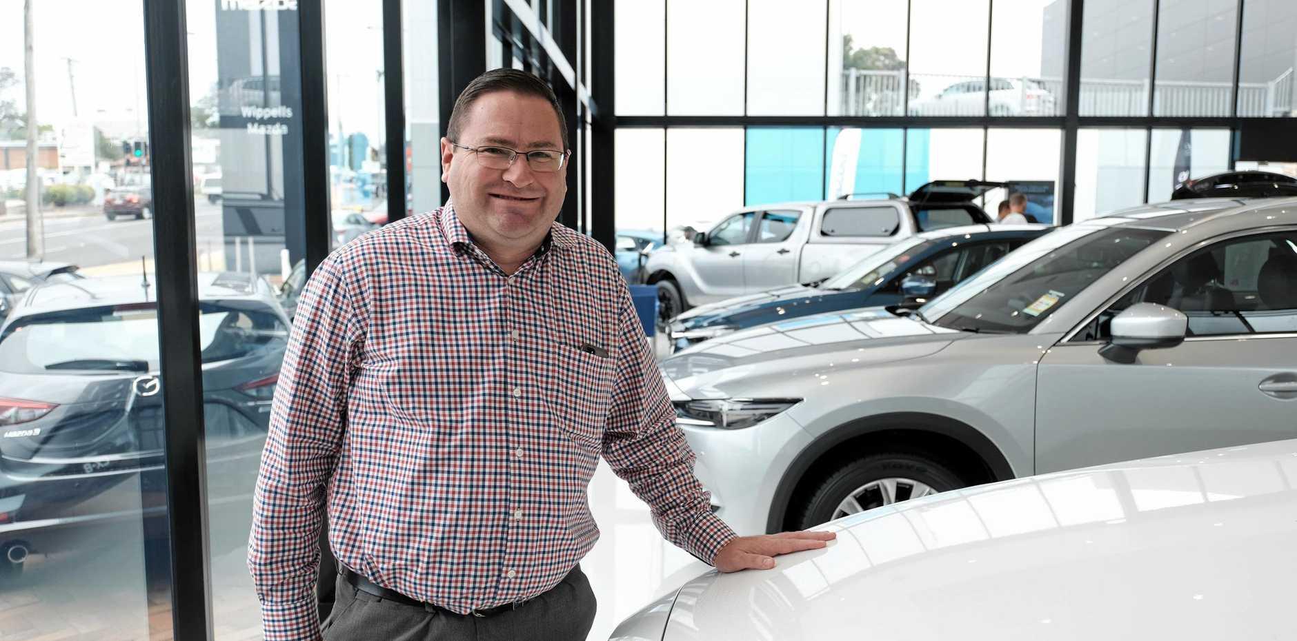 PLEASED: Wippells Mazda dealer principal David Russell, inside the new Wippells Mazda showroom on Herries St.