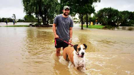 Cowboys player Kurt Baptiste with his 5yo Bull Arab Meeko enjoying the flooded waters. Picture: Alix Sweeney